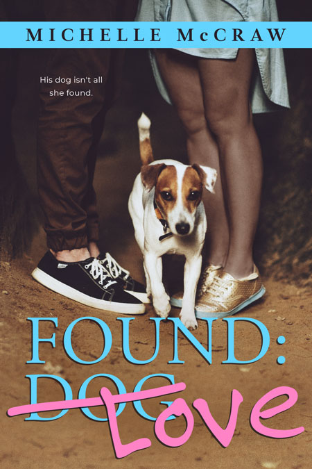 Cover of Found: Love by Michelle McCraw, a couple kissing (only their lower legs are visible) while standing on a forest path. A fox terrier steps between their feet toward the viewer